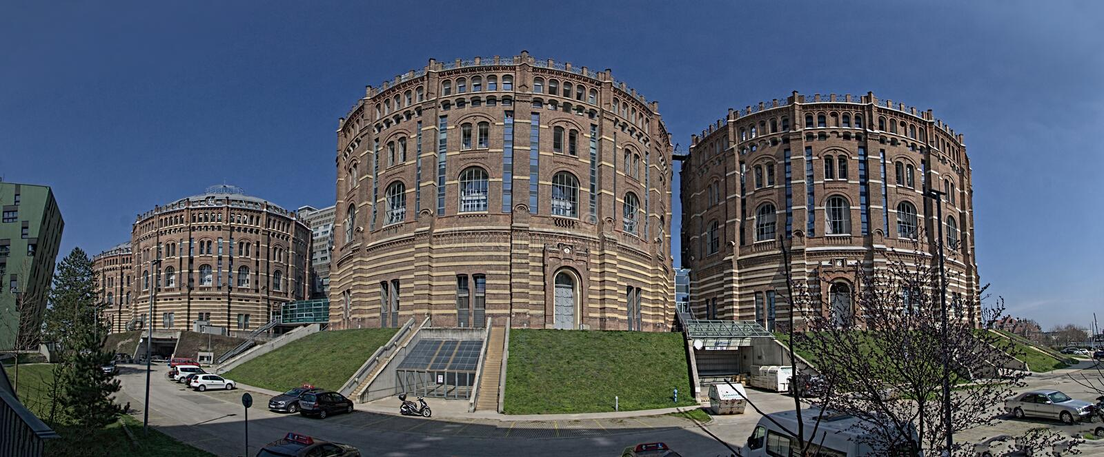 The Vienna Gasometer on sunny day in Vienna, Austria. The gasometers in Vienna-Simmering are four former gas tanks preserved in the facade. They have been royalty free stock photos