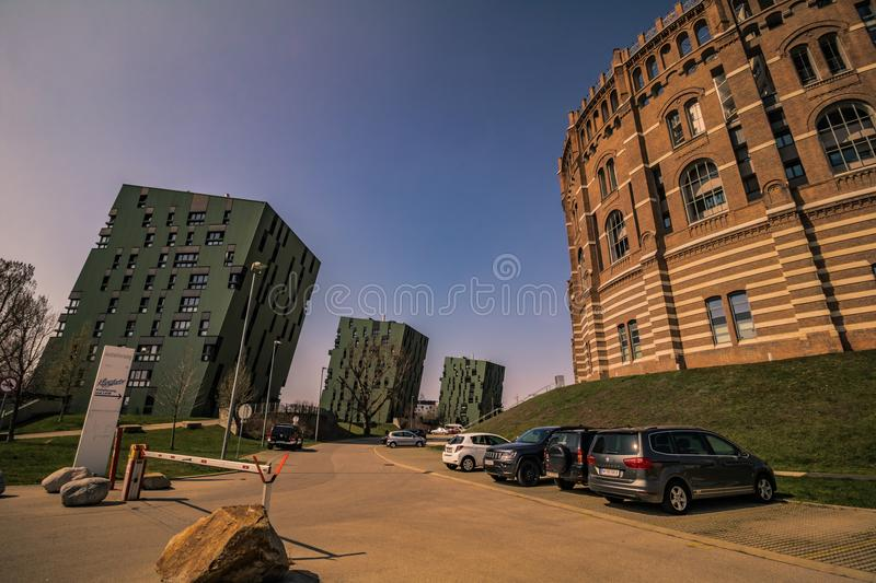 The Vienna Gasometer on sunny day in Vienna, Austria. The gasometers in Vienna-Simmering are four former gas tanks preserved in the facade. They have been stock photo