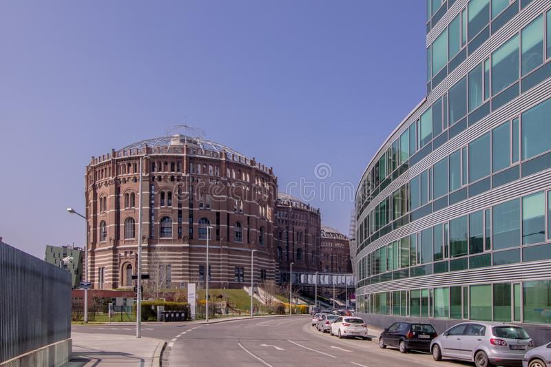 The Vienna Gasometer on sunny day in Vienna, Austria. The gasometers in Vienna-Simmering are four former gas tanks preserved in the facade. They have been royalty free stock photography