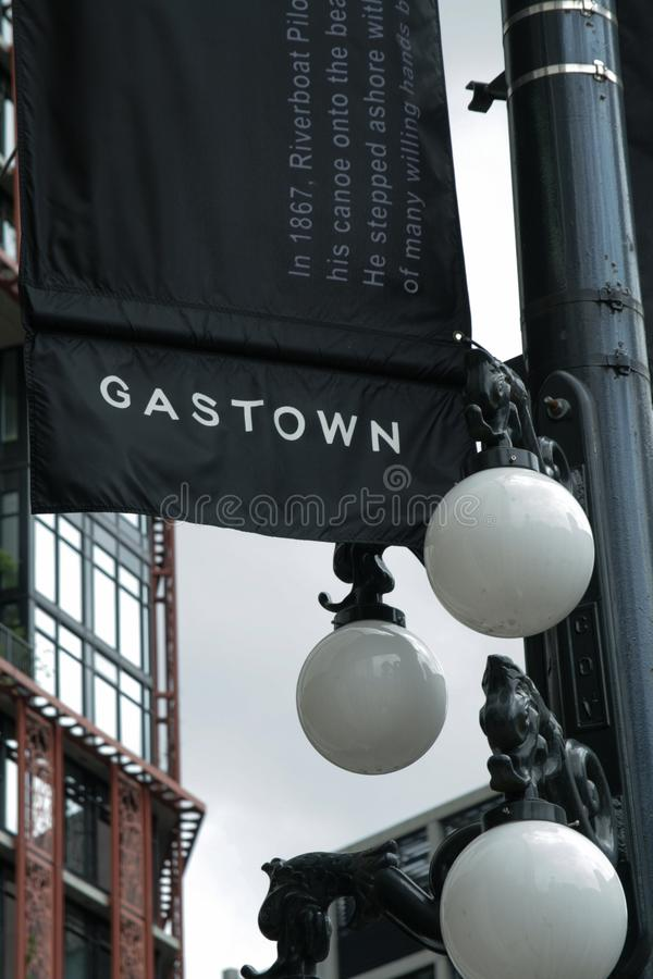 Gastown flag and street lamps, Vancouver, Canada. Gastown district of Vancouver, street lamps and black flag stock images