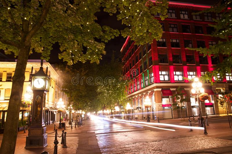 Gastown at night, Vancouver, British Columbia, Canada. The famous steam clock and other buildings in Vancouver, Canada's Gastown neighbourhood are shown at night stock photo