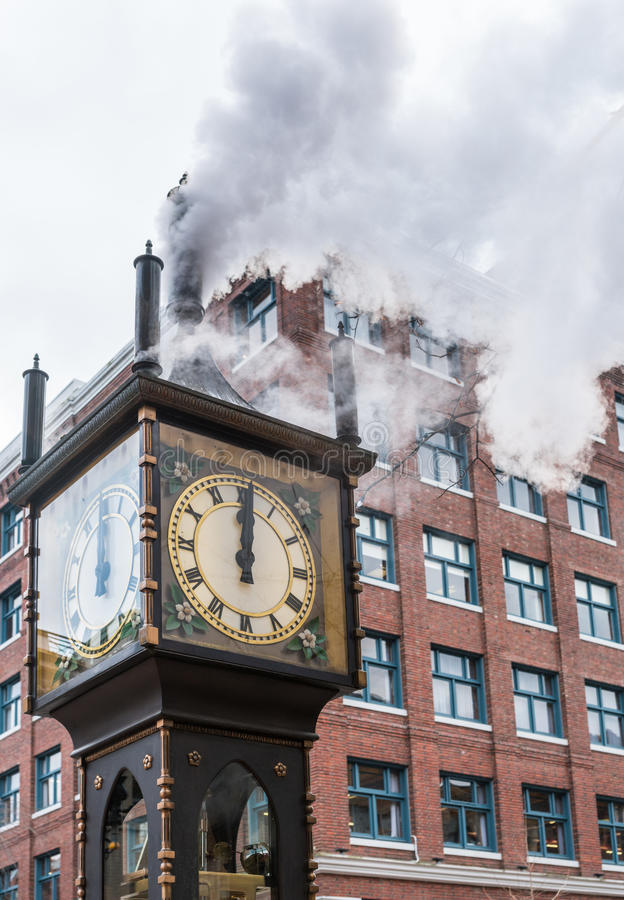 Gastown Steam Clock, Vancouver, Canada. The historic steam clock strikes midday in Gastown, downtown Vancouver, with jets of steam rising from the clock royalty free stock photos