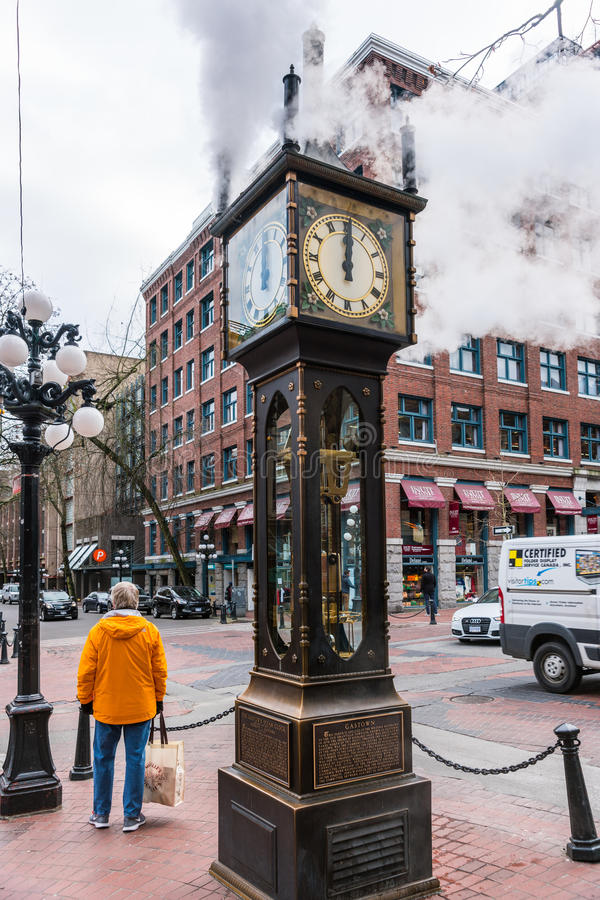Gastown Steam Clock, Vancouver, Canada. Vancouver, Canada - January 28, 2017: The historic steam clock strikes midday in Gastown, downtown Vancouver, with jets royalty free stock photos