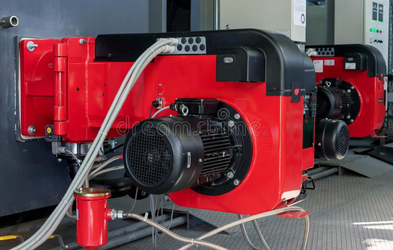 Gasutrustning på det moderna kokkärlrummet Gasgasbrännare med moduleringskontroll för förbränningen av gas eller diesel- bränsle  royaltyfri fotografi