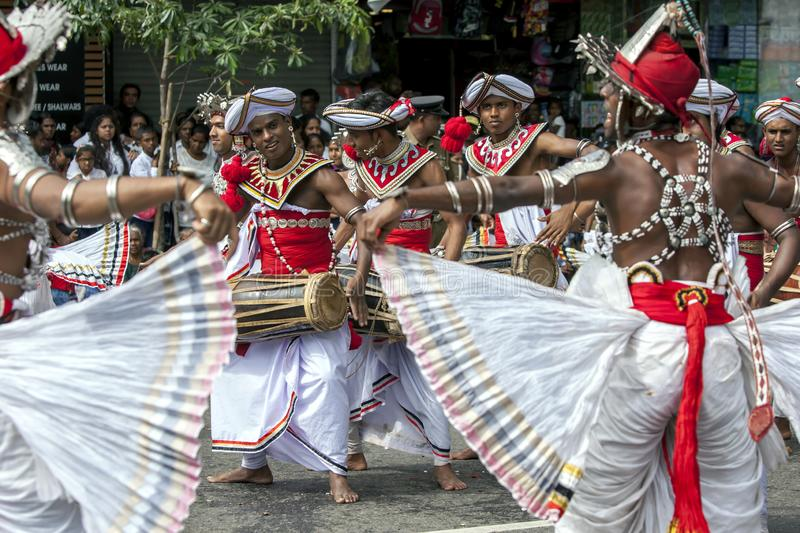 Gatabera Players and Up Country Dancers perform at Kandy in Sri Lanka. Gatabera Players and Up Country Dancers perform along a street during the Buddhist Day stock photography