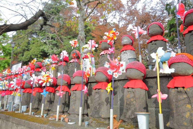 GataJizo buddha staty Tokyo Japan royaltyfri foto
