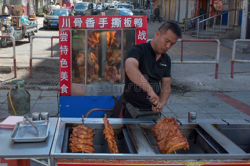 Gatamat, i Kina och att laga mat den royaltyfria bilder