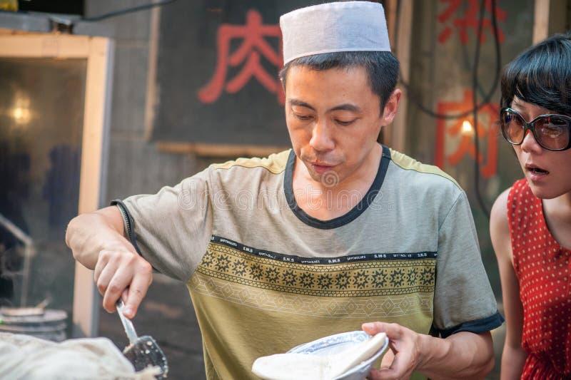 Gatamat på den muslimska gatan i Xian, Kina arkivbild