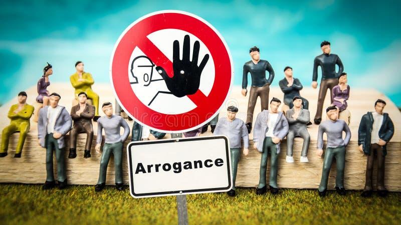 Gatatecken till arrogans f?r ?dmjukhet kontra arkivbild
