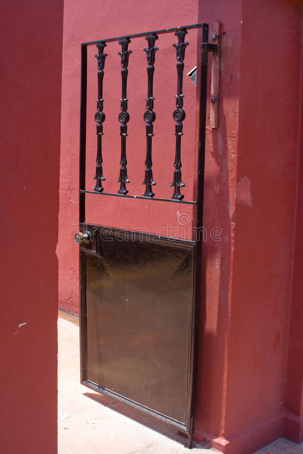 Gate. Wrought iron gate on a red building stock photography