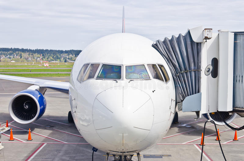 At the Gate. Airplane waits at the gate for departure royalty free stock image