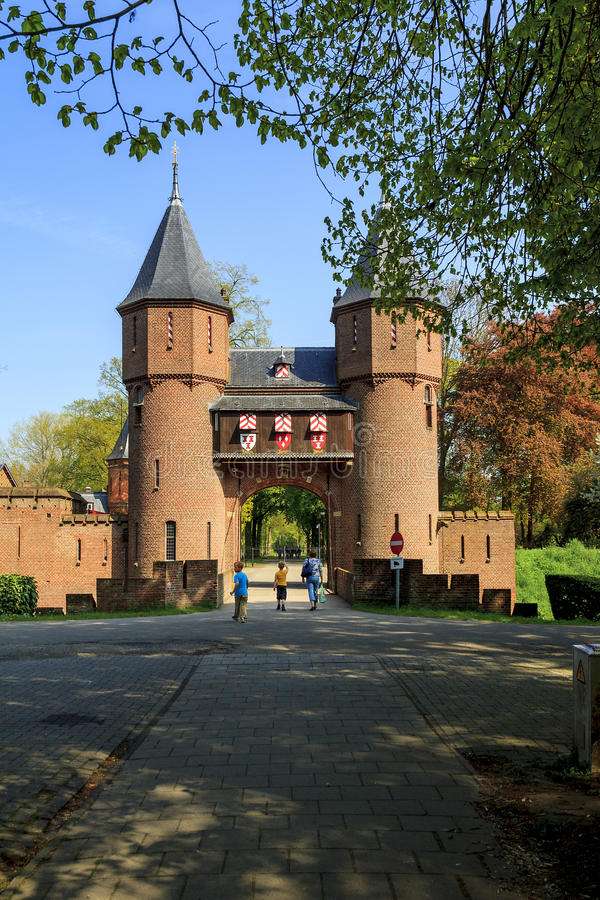 Gate into demense of the Castle de Haar, Netherlands. There are channel, wall and gate into demesne of the Castle de Haar May 6, 2013 in Haarzuilens, Netherlands stock photos