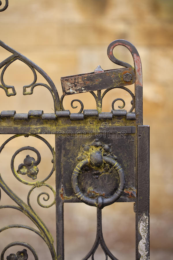 Gate Detail. An old wrought iron gate is found on the entrance to the historical church in Brandford on Avon. The fine detail of the gate is shown in the image royalty free stock photos