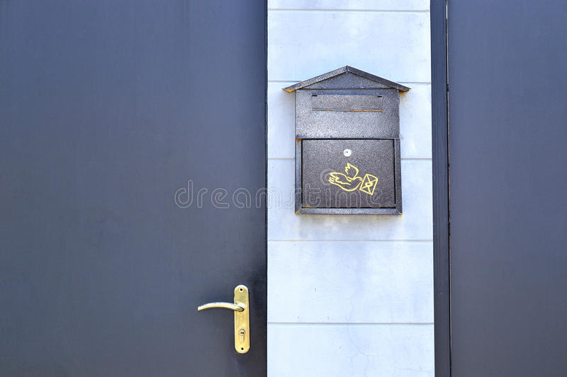 Gate door and mailbox. Gate door and a mailbox royalty free stock images