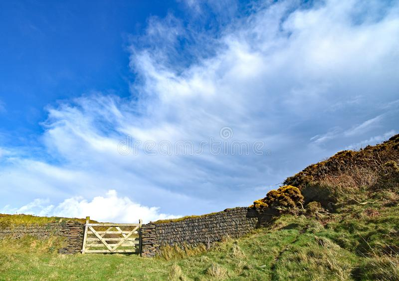 Gate and drystone wall royalty free stock photos
