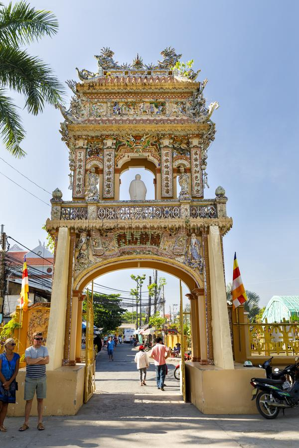Gate at the entrance to Buddha temple property in My Tho, Vietnam royalty free stock photography