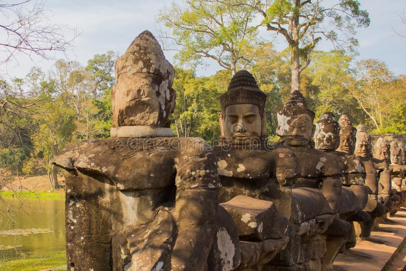 Gate Guardians ,stone sculptures in Angkor Wat, Cambodia. Stone soldiers stock photo