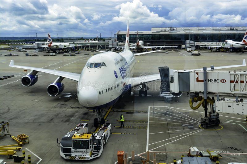 747 at Gate. 747 jumbo jet parks at gate at Heathrow Airport in London stock image