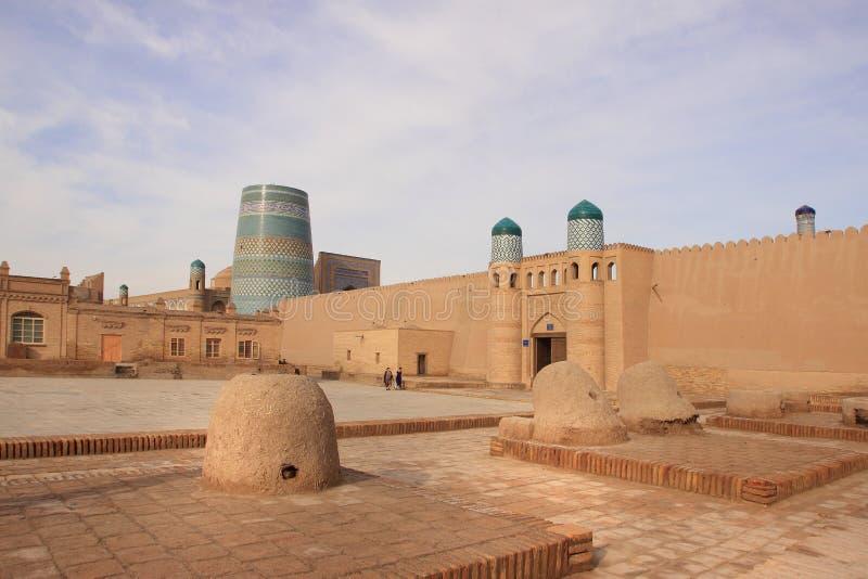 The gate of Kunya Ark Palace and the tandoors in Ichan Kala in Khiva city, Uzbekistan. Kunya-Ark Citadel ('Old Citadel') abuts on Khiva's royalty free stock photo