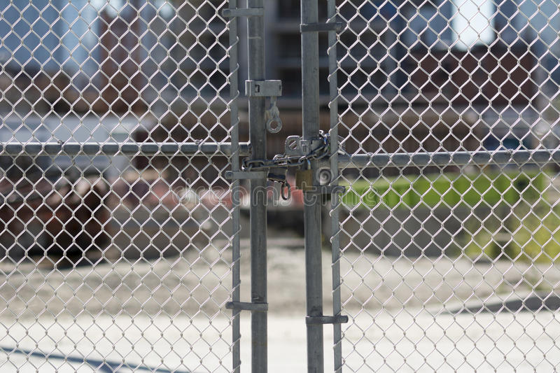 Gate Locked at Construction Site stock photo