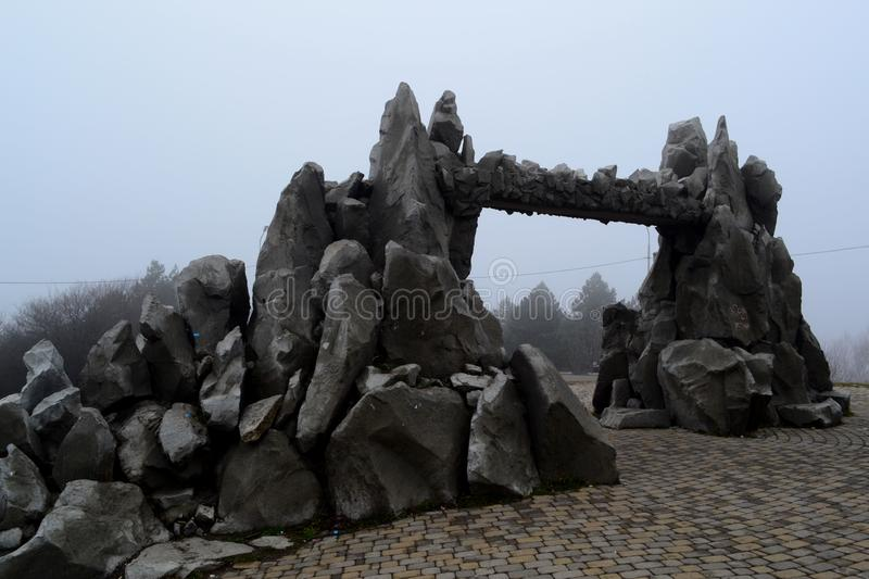 Gate of love on the mountain Mashuk in cloudy weather. Pyatigorsk, Russia. Landscape, stone, fog, foggy royalty free stock photos