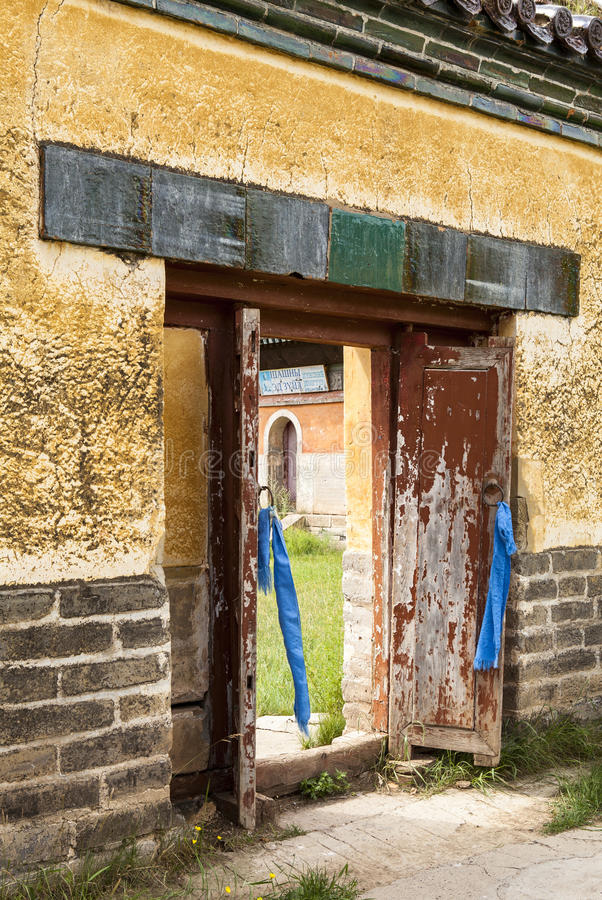 The Gate of monastery in Mongolia. Buddhism in Mongolia derives much of its recent characteristics from Tibetan Buddhism of the Gelug and Kagyu lineages royalty free stock image
