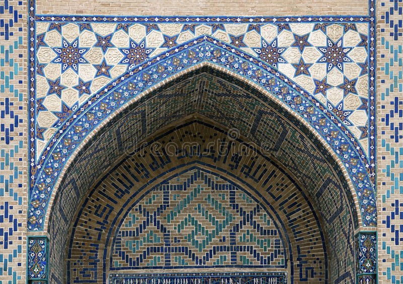 Gate of a mosque in Samarkand. Arch portal of a mosque in Samarkand, Uzbekistan royalty free stock image