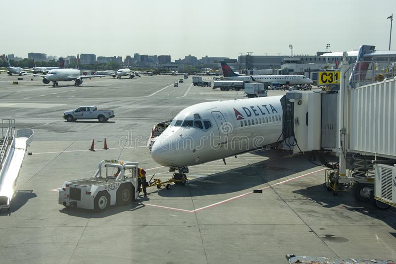 At the gate. New York City, NY, United States - June 3, 2019: Delta Aircraft at the gate at New York`s LaGuardia Airport in Queens royalty free stock image