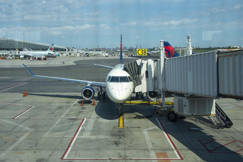 At the gate. New York City, NY, United States - June 3, 2019: Delta Aircraft at the gate at New York`s LaGuardia Airport in Queens stock image