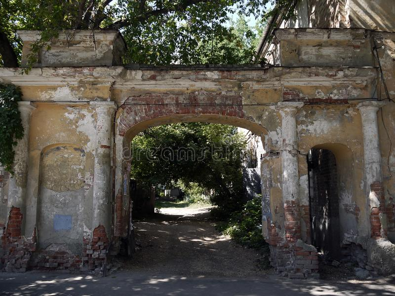 The gate of the old house and a view of the courtyard. The photo gate of an old house and a view of the courtyard royalty free stock photography