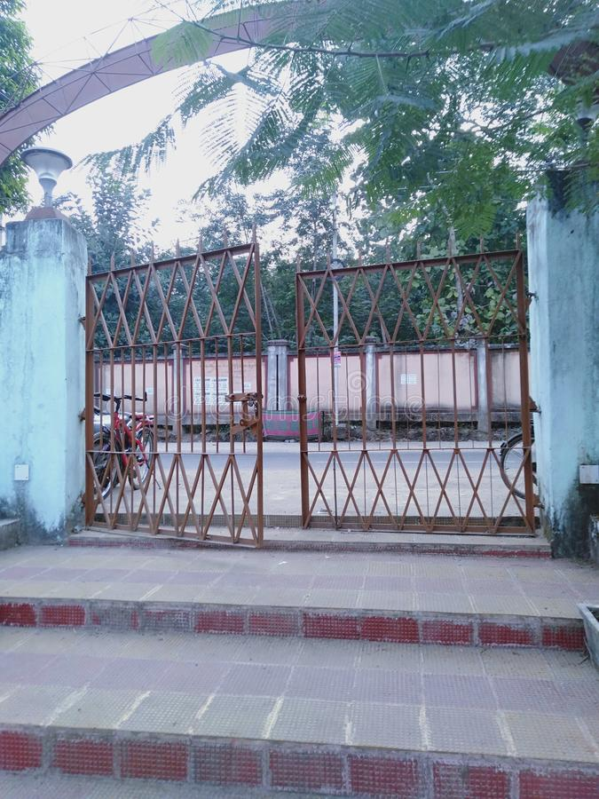 Gate of a park at sambalpur odisha india. Park attached to a street road and trees reflected in the picture royalty free stock images