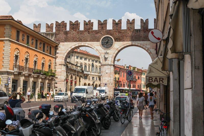 Gate Portoni della Bra in Verona, Italy. Verona, Italy - July 18, 2013: Busy street in Verona with Portoni della Bra, medieval gate leading to the Piazza Bra in stock photos