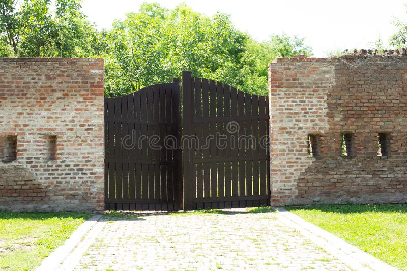 Gate inside Alba Carolia Fortress in Alba Iulia. Gate and street view of walking alley inside Alba Carolia Fortress in Alba Iulia, Romania on a sunny day with stock photography