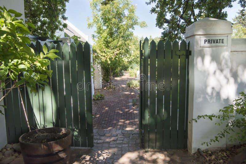 Gate to the private garden stock photo