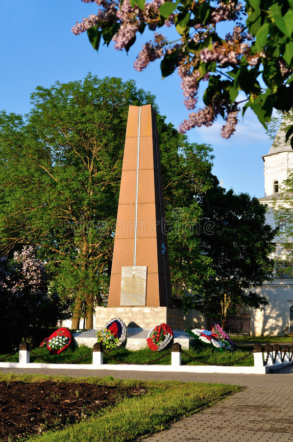 Gate tower of Yaroslav`s courtyard and the monument to heroes of Great Patriotic War at spring sunset in Veliky Novgorod, Russia. VELIKY NOVGOROD, RUSSIA - MAY royalty free stock images
