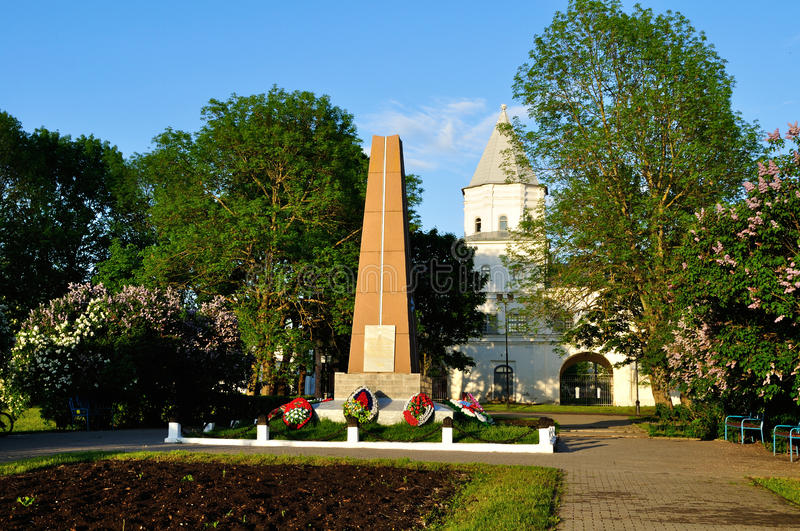 Gate tower of Yaroslav`s courtyard and the monument to heroes of Great Patriotic War at spring sunset in Veliky Novgorod, Russia. VELIKY NOVGOROD, RUSSIA - MAY stock photos