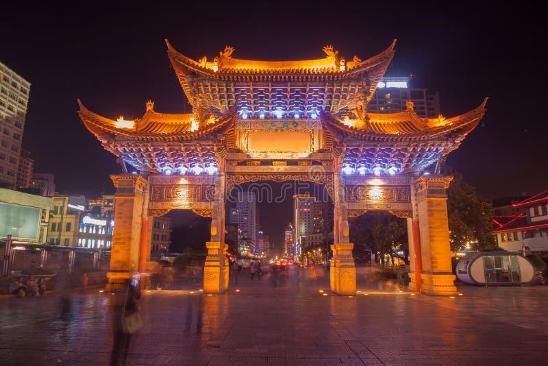 The gate of Yunnan Nationalities Village and many people are visiting  at  Kunming City, Yunnan Province, China.  royalty free stock photo