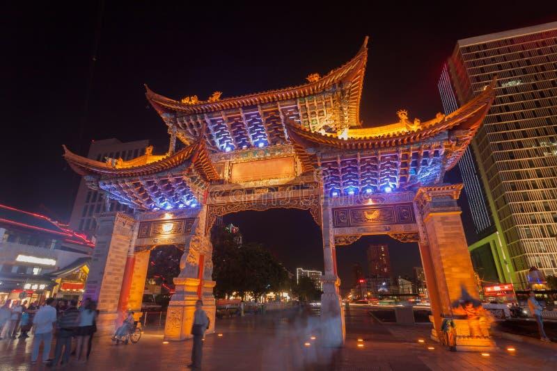 The gate of Yunnan Nationalities Village and many people are visiting  at  Kunming City, Yunnan Province, China.  stock photography