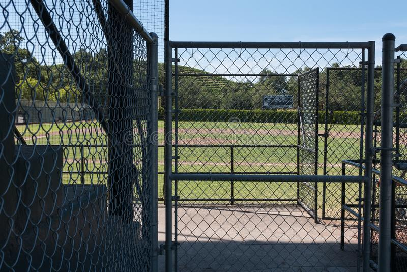 Gates and fences at a baseball diamond stock photo