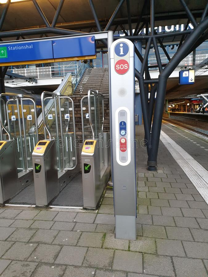 Gates at the railroad station Amsterdam Sloterdijk to be opened with payment card for trains in the Netherlands stock photo