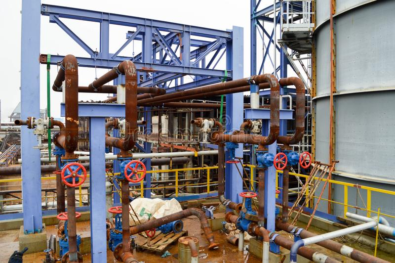 Gates, rusted pipe fittings in petrochemical production. stock photos