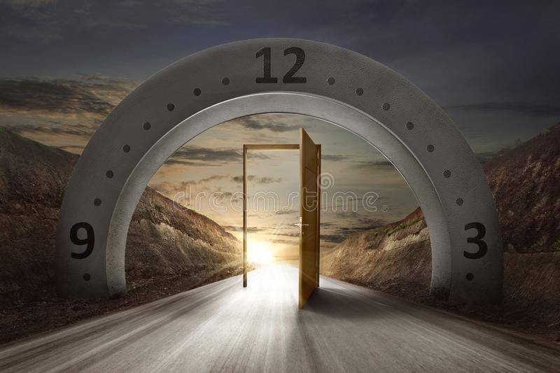 Gateway arch with clock face and open door. On the empty road. Daylight Savings Time Concept royalty free stock photos