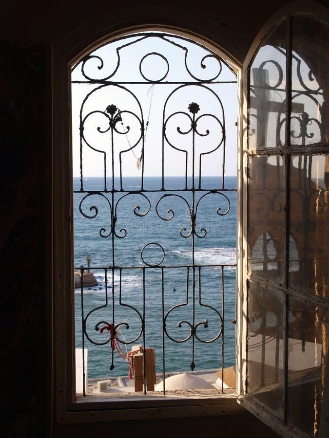 Gateway to the sea ocean view. The Mediterranean through an open window stock photo