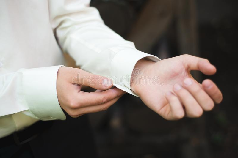 Gathering of the groom , groom buttons cuffs. stock image