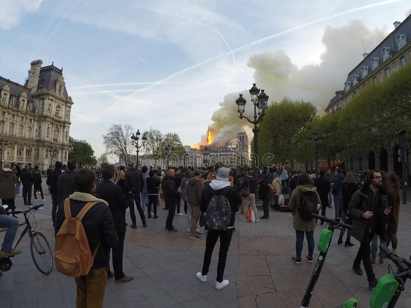 People watch stunned as Notre Dame burns, Paris, France, 15th April 2019 stock photography