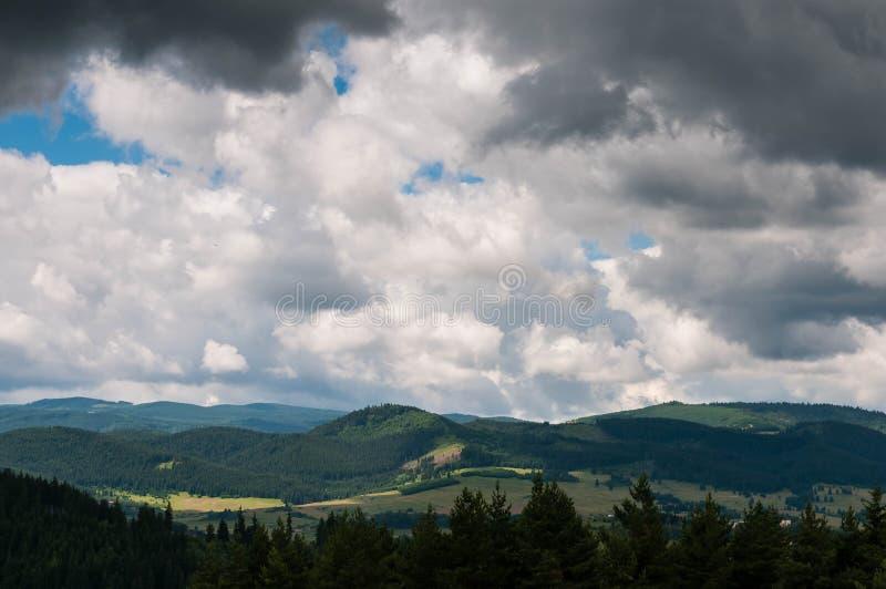 Gathering storm clouds over Carpathian mountains stock photos