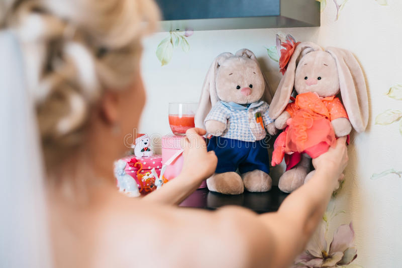 On the gatherings bride holding his soft toy royalty free stock photos