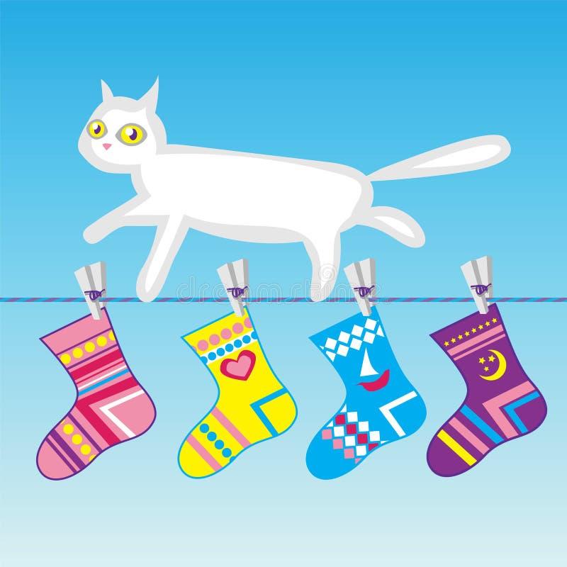 Gato branco em uma linha de roupa foto de stock