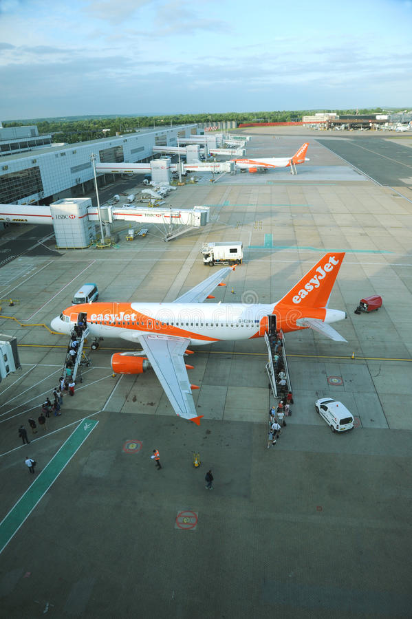 Gatwick airport. Easy Jet loading passengers. Busy ground operations at Gatwick airport stock image