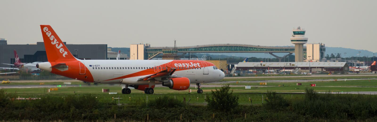 GATWICK AIRPORT, ENGLAND, UK – AUGUST 30 2018: An easyJet Airlines plane prepares to take off from Gatwick Airport. Overlooked by the air traffic control stock photos